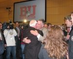 Embracing Dave Silk, 1980 Olympian and one of many former BU players who came to press conference