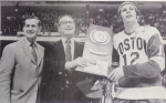 NCAA Tournament chairman Herb Gallagher, left, presents 1972 national championship trophy to Kelley and captain John Danby.