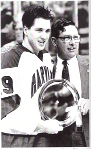 Lane MacDonald accepts MVP trophy from Garden VP Steve Nazro after Harvard defeated BU 9-6 for the 1989 Beanpot title.