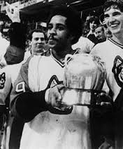 "Wayne Turner holding the coveted Pot in 1980. Is there any wonder that NU hockey fans refer to the man from Kitimat, British Columbia as ""Beanpot?"""