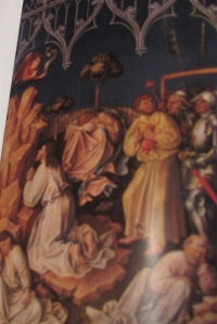 Red-headed Judas leads the soldiers to Jesus in Gethsemane.
